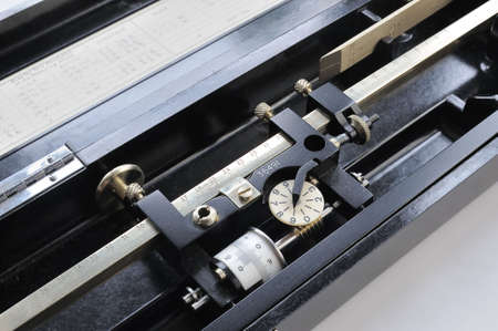 calibrated: Detail of a English polar planimeter -- an instrument used to measure the area of an arbitrary two-dimensional shape -- from the 1950s in its bakelite case.