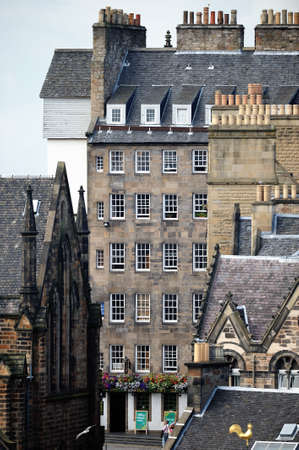 mile: Milnes Court on the Lawnmarket, top of the Royal Mile, Old Town, Edinburgh, with characteristic sash and case windows.  There has been a pub on this site from the 17th Century.  The current one is named after the Ensign Charles Ewart who fought at Waterl