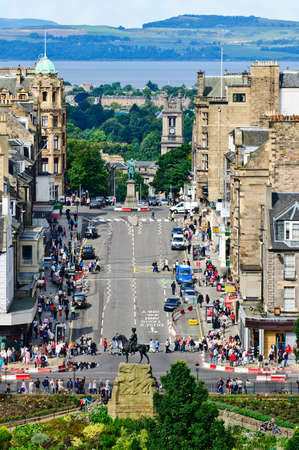 citylife: Frederick Street, Edinburgh, Scotland, with the statue commemorating the Royal Scots Greys departure for the South African War in 1899, a statue of William Pitt the younger, St Stephens Church, and looking across the Firth of Forth to Fife.