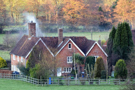 rural scenes: Snug English country house at dusk as Autumn turns to Winter