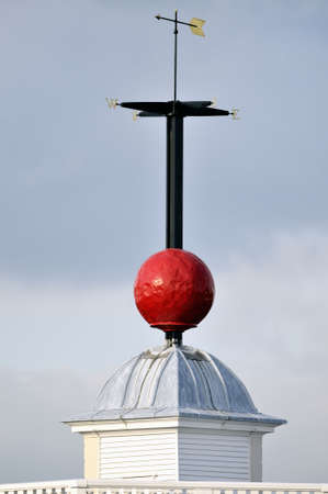 civilisations: Bright red Time Ball, on top of Flamsteed House, Royal Observatory, Greenwich, London, England, UK, is one of the worlds earliest public time signals. The present Ball dates back to 1919. Stock Photo