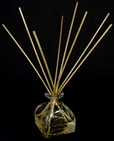 wicks: clear glass bottle of perfume with reeds or wicks to dispense the scent by capillary action -- an air freshener