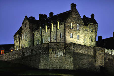 nightfall: Edinburgh Castle, illuminated at nightfall, in winter from the north west. Stock Photo