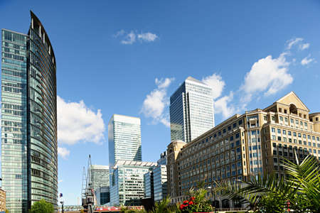 docklands: Canary Wharf London England UK from West India Quay on a sunny afternoon Stock Photo