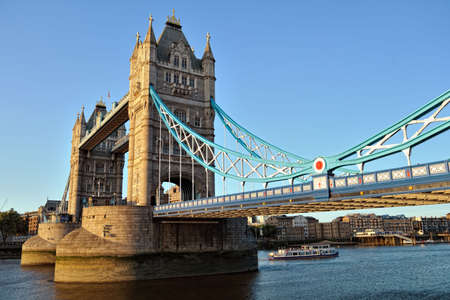 Tower Bridge, London, England, UK, Europe, from the east, catching the setting sun on a clear day photo