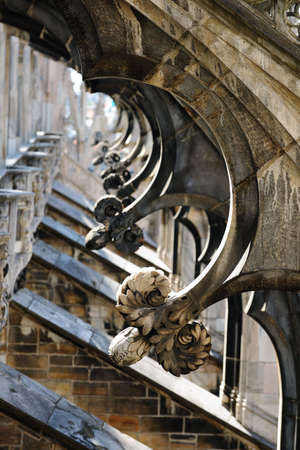 Detail of flying buttresses supporting the roof of Milan cathedral, with statues on top of spires, Lombardy, Italy Stock Photo