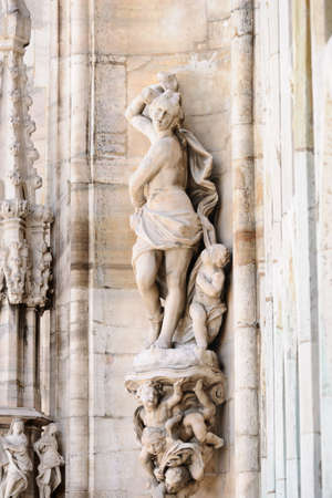 cherubs: Statue of woman and cherubs on the roof of Milan Cathedral, Lombardy, Italy