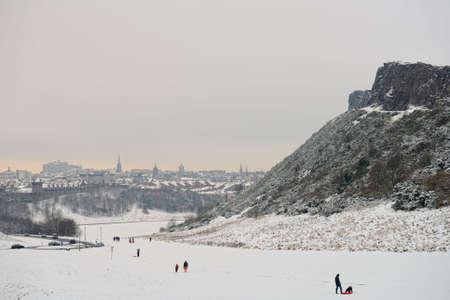 Edinburgh, Scotland, UK, skyline, looking over Holyrood Park, in the snow.  On the right, Salisbury Crags.