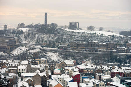 Calton Hill, Edinburgh, Scotland, UK, from the south, in the snow.  Fife is just visible across the Firth of Forth. Stock Photo - 6288746