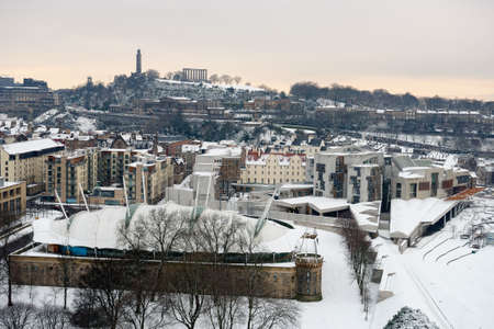 scottish parliament: Scottish Parliament Building at Holyrood, Edinburgh,Scotland,UK, with Dynamic Earth centre in the foreground, and Regent Terrace, and Calton Hill in the background, in the snow