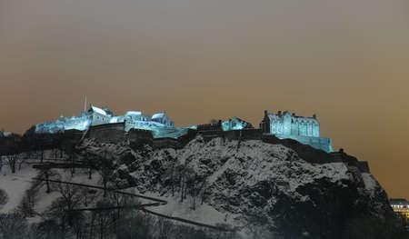 Edinburgh Castle, Scotland, UK, illuminated at night in the winter snow