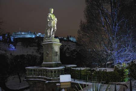 princes street: Statue of the Scottish poet Allan Ramsay, Princes Street Gardens, Edinburgh,Scotland,UK.  Edinburgh Castle is in the background.