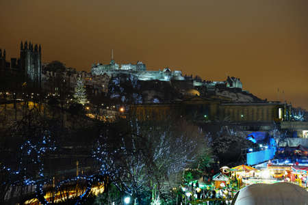 princes street: Edinburgh skyline at night from East Princes Street Gardens, Scotland, UK, with the Assembly Hall and Castle at the rear and Christmas fair at the bottom right