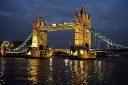 famous place: Tower Bridge, London, England, UK, Europe, illuminated at dusk