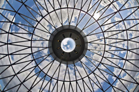 glass ceiling: Looking at the sky through the dome of a skyscraper -- the proverbial glass ceiling? Stock Photo