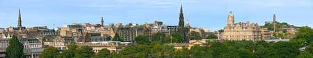 edinburgh: Panoramic view of East End of Princes Street, Edinburgh, Scotland, with the Scott Monument, Balmoral Hotel, and Calton Hill on the skyline, roofs of the Royal Scottish Academy and National Gallery of Scotland in the foreground.