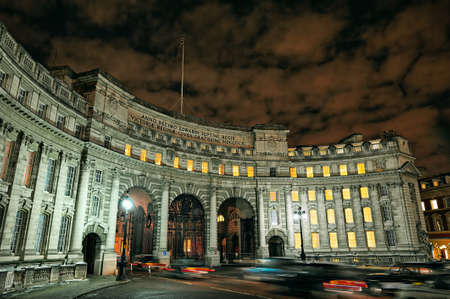 king edward: Admiralty Arch, Mall, London, England, UK, Europe, illuminated at night in winter.  Admiralty arch is a ceremonial gateway that leads from the southwest corner of Trafalgar Square into The Mall. It was commissioned by King Edward VII in memory of his moth Stock Photo
