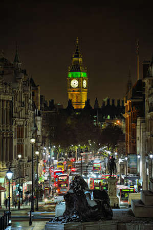 Looking down Whitehall towards Big Ben from Trafalgar Square, London, England, UK, at night in winter photo
