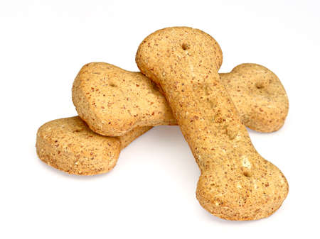 Pile of bone-shaped dog biscuits, isolated on white background