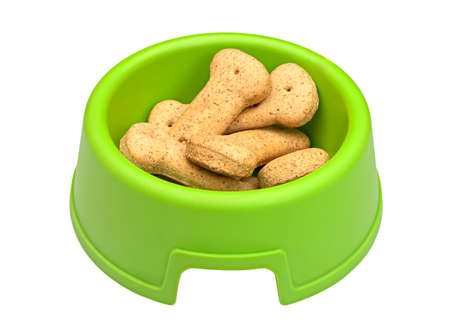 Green bowl of bone-shaped dog biscuits, isolated on white background with clipping path photo