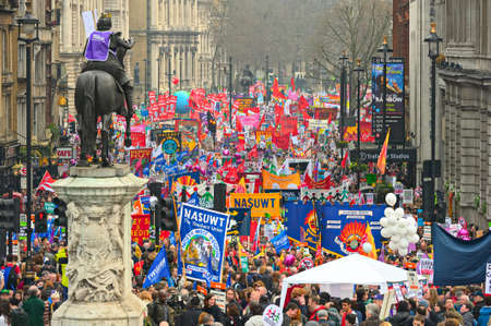 protestor: LONDON - MARCH 26: Protesters march down Whitehall against public expenditure cuts in a rally -- March for the Alternative -- organised by the Trades Union Congress (TUC), London, England,  March 26 2011