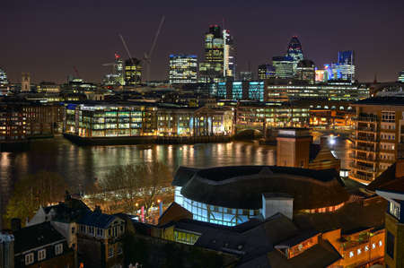 Looking over Shakespeares Globe Theatre and the River Thames towards the City of London, England, UK, Europe, at night photo