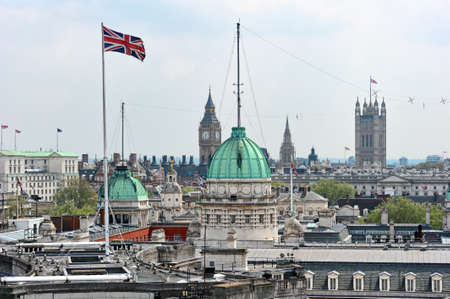 Rooftop view over Whitehall, London, England, UK, with the roof of the Old Admirality Building in the centre.  The Union Jack is on top of Admiralty Arch.