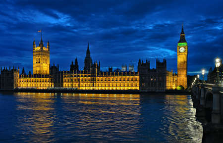 Palace of Westminster and the River Thames, London, England, UK, Europe, at night.
