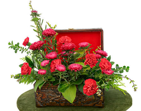casket: Arrangement of red flowers in a wooden case Stock Photo