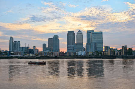 docklands: Canary Wharf at sunset, looking over the River Thames, from the east, London, England, UK, Europe