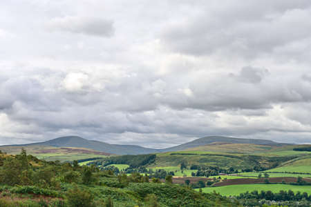 Hedgehope Hill (left) and the Cheviot (right), Northumberland National Park, England, UK, Europe, on a cloudy day