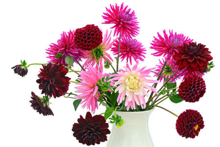 Flower arrangement of dark red and pink chrysanthemums and dahlias in a vase