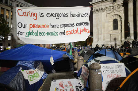 anti capitalist: LONDON, UK - OCTOBER 30 2011: Occupy London Stock Exchange protesters Editorial