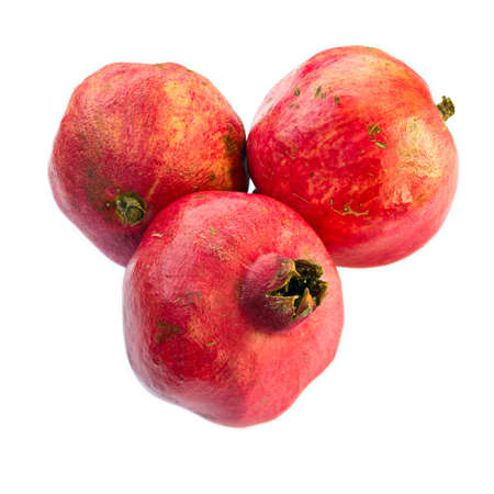 ripeness: Three ripe, natural pomegranates, isolated on white background