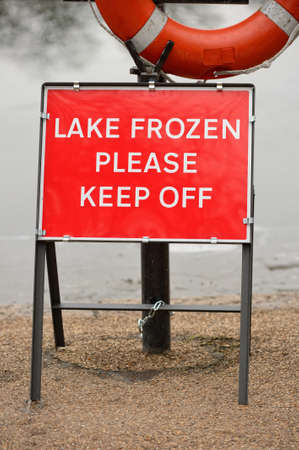 Bright red  Lake Frozen Please Keep Off  warning sign
