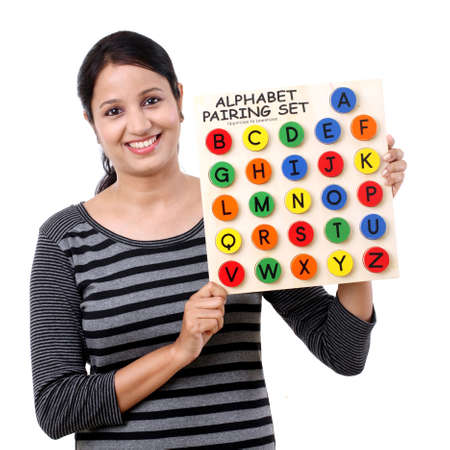 Young woman showing wooden alphabets Stock Photo