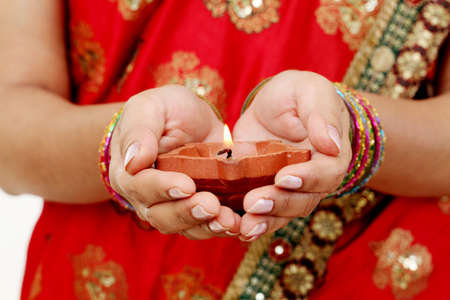 fire crackers: Hands holding A traditional Indian oil lamp Stock Photo