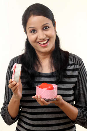 Young happy woman opening a gift box Stock Photo