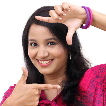 Cheerful young woman creating a frame with fingers Stock Photo