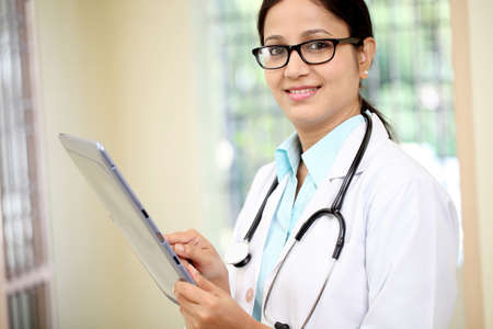 Female doctor using tablet computer Stock Photo