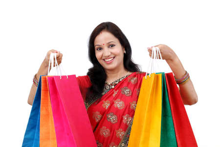 Traditional Indian woman holding shopping bags