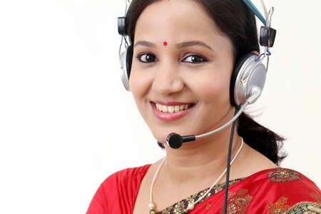 Happy young traditional woman wearing headset