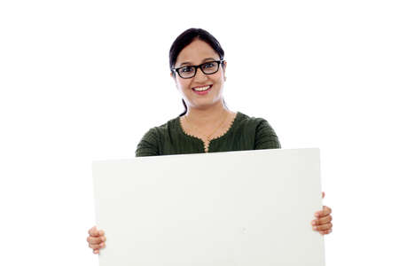 Young woman holding blank card against white background