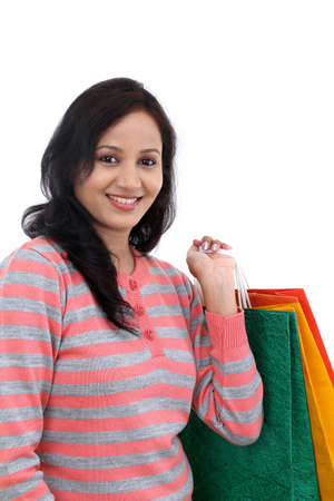 Young happy smiling woman with shopping bags Stock Photo