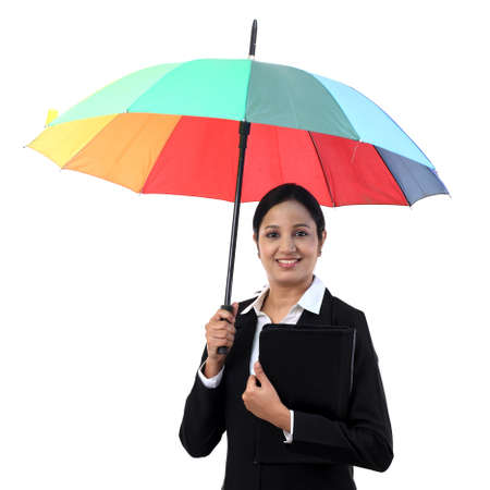 Young happy businesswoman holding a umbrella Stock Photo