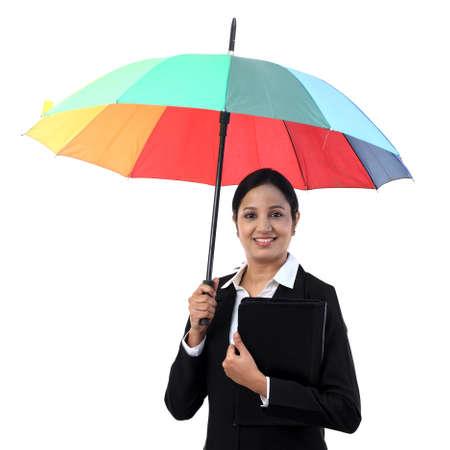 Young happy businesswoman holding a umbrella Banco de Imagens