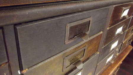 drawers: antique wooden paper cabinet with drawers with metal name plates Stock Photo