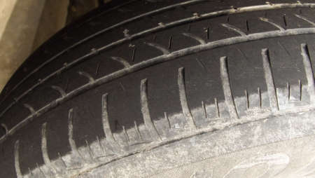 tread: Very Worn Car and auto tire tread