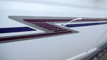 White car body with blue, grey, and burgundy car stripping,