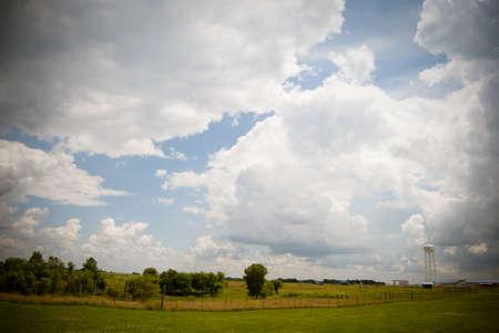 Cloudy sky and farm landscape. Stockfoto